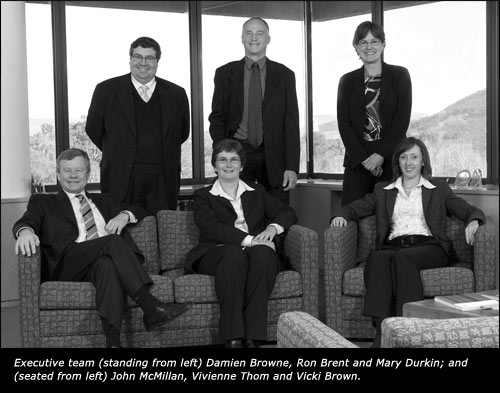 Executive team (standing from left) Damien Browne, Ron Brent and Mary Durkin; and (seated from left) John McMillan, Vivienne Thom and Vicki Brown.