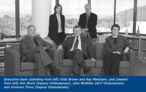 Executive team (standing from left) Vicki Brown and Ray Matcham; and (seated from left) Ron Brent (Deputy Ombudsman), John McMillan (ACT Ombudsman) and Vivienne Thom (Deputy Ombudsman).