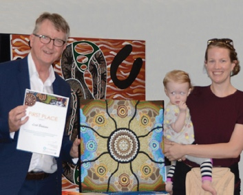 Image ACT Ombudsman Michael Manthorpe PSM with art competition winner Leah Brideson